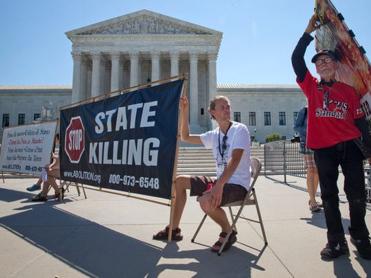 Demonstrators gathered outside the Supreme Court in