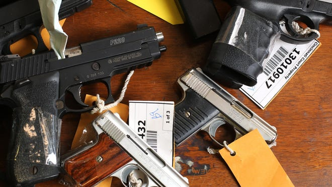 Guns confiscated by the Cincinnati Police Department are held as evidence.