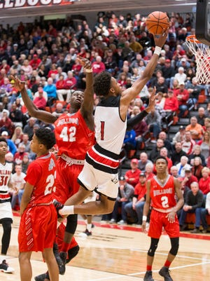 New Albany's Romeo Langford (1) goes for a layup during the game between New Albany and Evansville Bosse at New Albany High School.