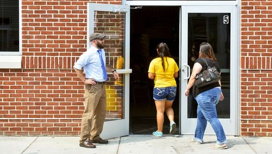 Helen Thackston Charter School's dean of students, Michael Terwilliger, greets arriving students and parents at an open house in 2015.