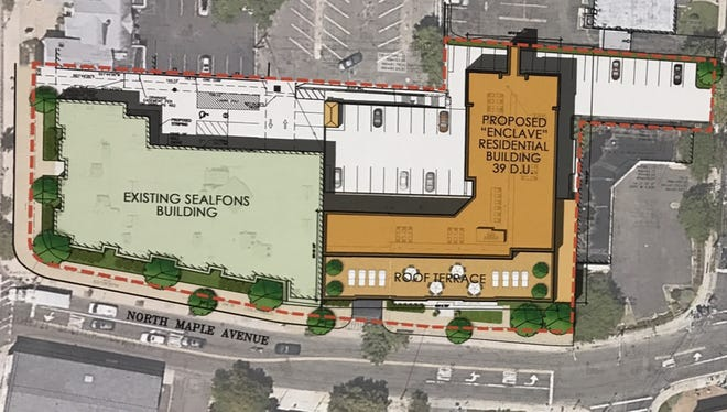 This site plan illustrates the relationship between the proposed Enclave apartment complex and the existing Sealfons building, which will be developed to house commercial offices and eight affordable units for residents with developmental disabilities.