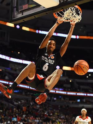 March 30, 2016; Chicago;  McDonalds High School All-American East's Terrance Ferguson dunks during the first half at the United Center.