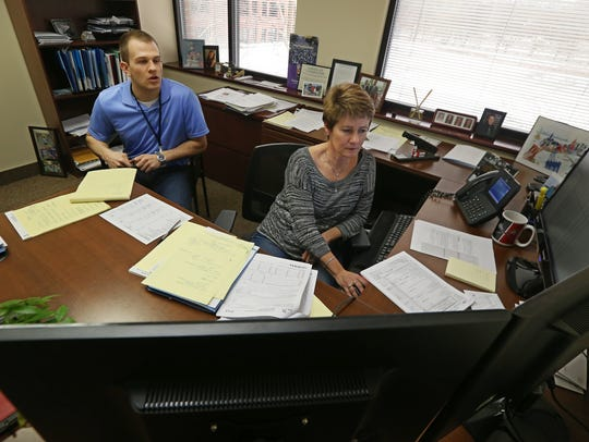 Leah Powell, partner, right, meets with Alex Proper,