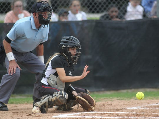 NFC eighth grade catcher Emma Brice prepares to field