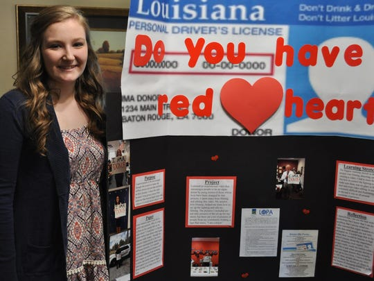 Pineville High School Senior Lauren Dalme decorated the board for her senior project presentation with pictures of organ donors at her school and around the community.