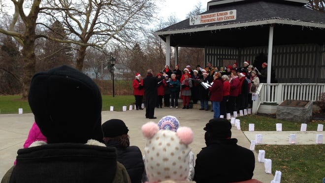 The Irondequoit Chorale sings to the crowd.