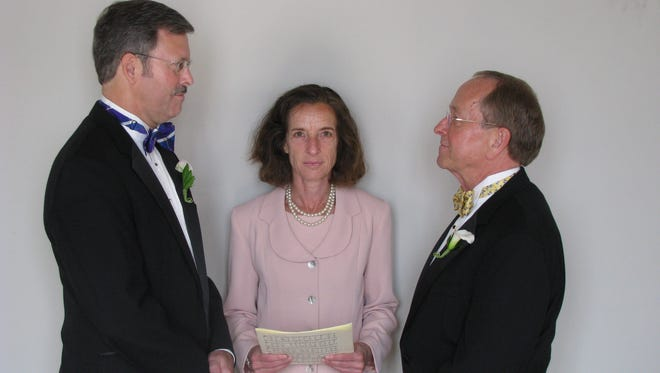 Bishop Robinson, right, marries Mark Andrew in 2008.