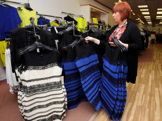 Shop manager Debbie Armstrong places two tone dresses
