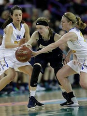 Howards Grove High School's Samantha Yancy, left, and Kaitlynn Near, right, defend against Aquinas High School's Lexi Donarski during their WIAA Division 4 State Tournament final girls basketball game Friday, March 10, 2017, at the Resch Center in Ashwaubenon, Wis.