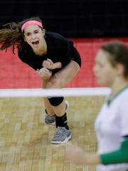 Lourdes Academy's Rachel Aasby celebrates a point against Benton on Friday.