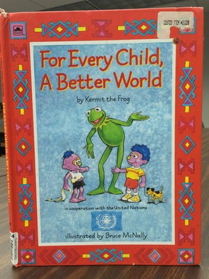 """The book """"For Every Child a Better World"""" by Jim Henson."""