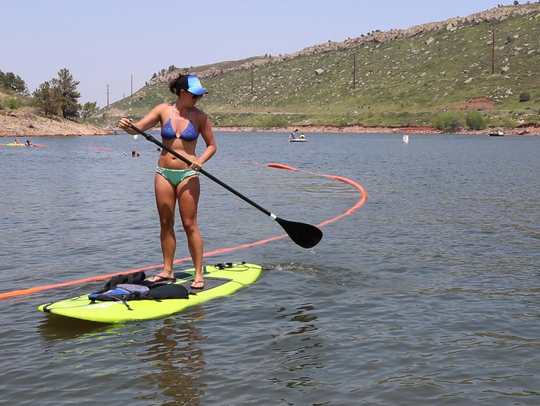 A paddleboarder returns to the South Bay shoreline