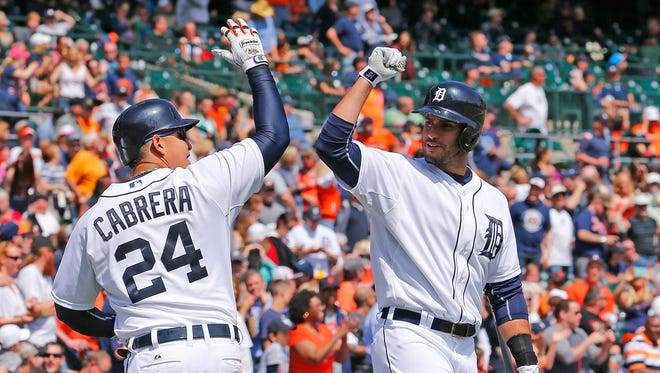Miguel Cabrera of the Detroit Tigers celebrates with teammate J.D. Martinez.