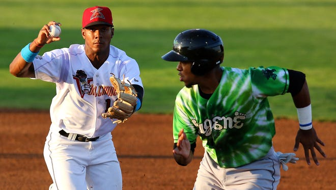 Volcanoes second baseman Junior Amion chases down Eugene baserunner Alex Bautista after he was caught in a pickle at Volcanoes Stadium, Thursday, August 20, 2015, in Keizer, Ore.