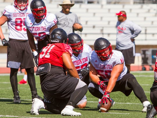 The Southern Utah offensive line looks to the sideline