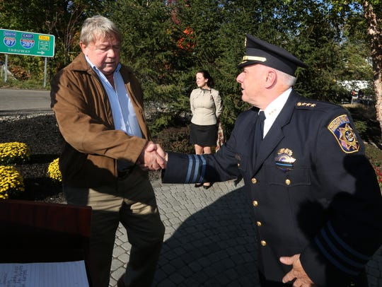 Brian Lennon, left, greets Rockland County Undersheriff Robert Van Cura before the 34th annual Brinks Memorial Service in Nyack Oct. 20, 2015. Lennon, a South Nyack Police Officer who survived the Brinks robbery , died in 2017.