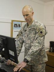 SFC Harris using the computer.