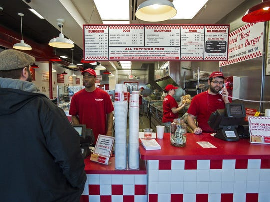 Five Guys Burgers in South Burlington on Thursday, March 3, 2016.  A bill has been proposed in the legislature that would prohibit employers from asking prospective employees about their criminal records. Many of the employees at Five Guys, such as Antwaun Twitty, left, have had run-ins with the law before.