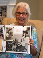 Helen Birchell shows a photo from her wartime work