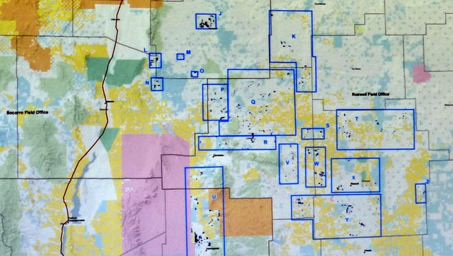The map shows identified BLM land outlined in blue for possible swap to the state land office primarily in the counties of Lincoln, Chaves, Torrance and Otero.
