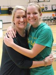 St. John Neumann girls basketball coach Sarah McFee, left, hugs younger sister and senior Celtics player Sophie McFee