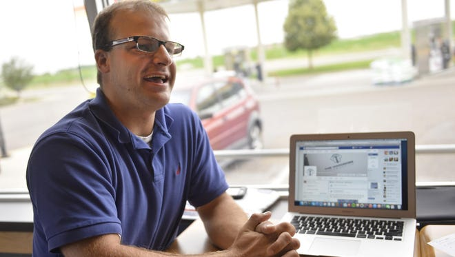 Darrin Pence smiles as he talks about his online business, The Wardrobe Vault, on July 1 in Sartell. He buys clothing overstock items and resells them.