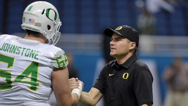 Jan 2, 2016; San Antonio, TX, USA; Oregon Ducks head coach Mark Helfrich shakes hands with Ducks offensive lineman Tyler Johnstone (64) during the 2016 Alamo Bowl against the TCU Horned Frogs at Alamodome. Mandatory Credit: Kirby Lee-USA TODAY Sports