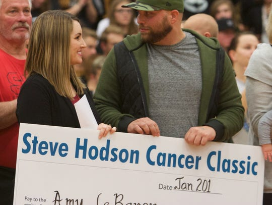 Three local families were presented with $5,000 each on Friday to help in their fight against cancer.