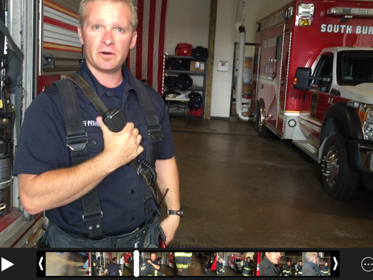 A firefighter demonstrates radio communications on