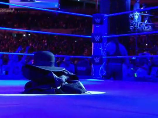 The Undertaker's gear remains in the ring after he
