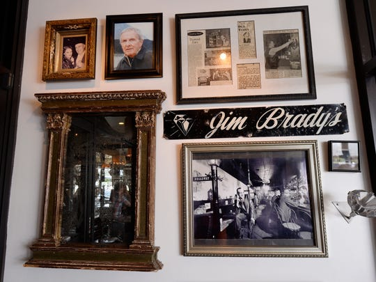 A collage of photos and clippings hang on the wall at the entrance of Diamond Jim Brady's.
