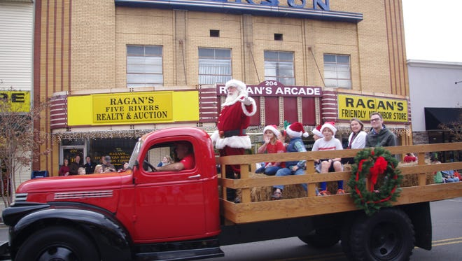 Santa waves during the 2014 Dickson Christmas Parade.