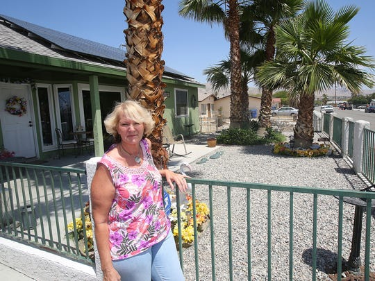 Marieann Johansen removed all grass from her yard and only her trees are watered with drip irrigation at her Desert Hot Springs home, seen here on Monday.