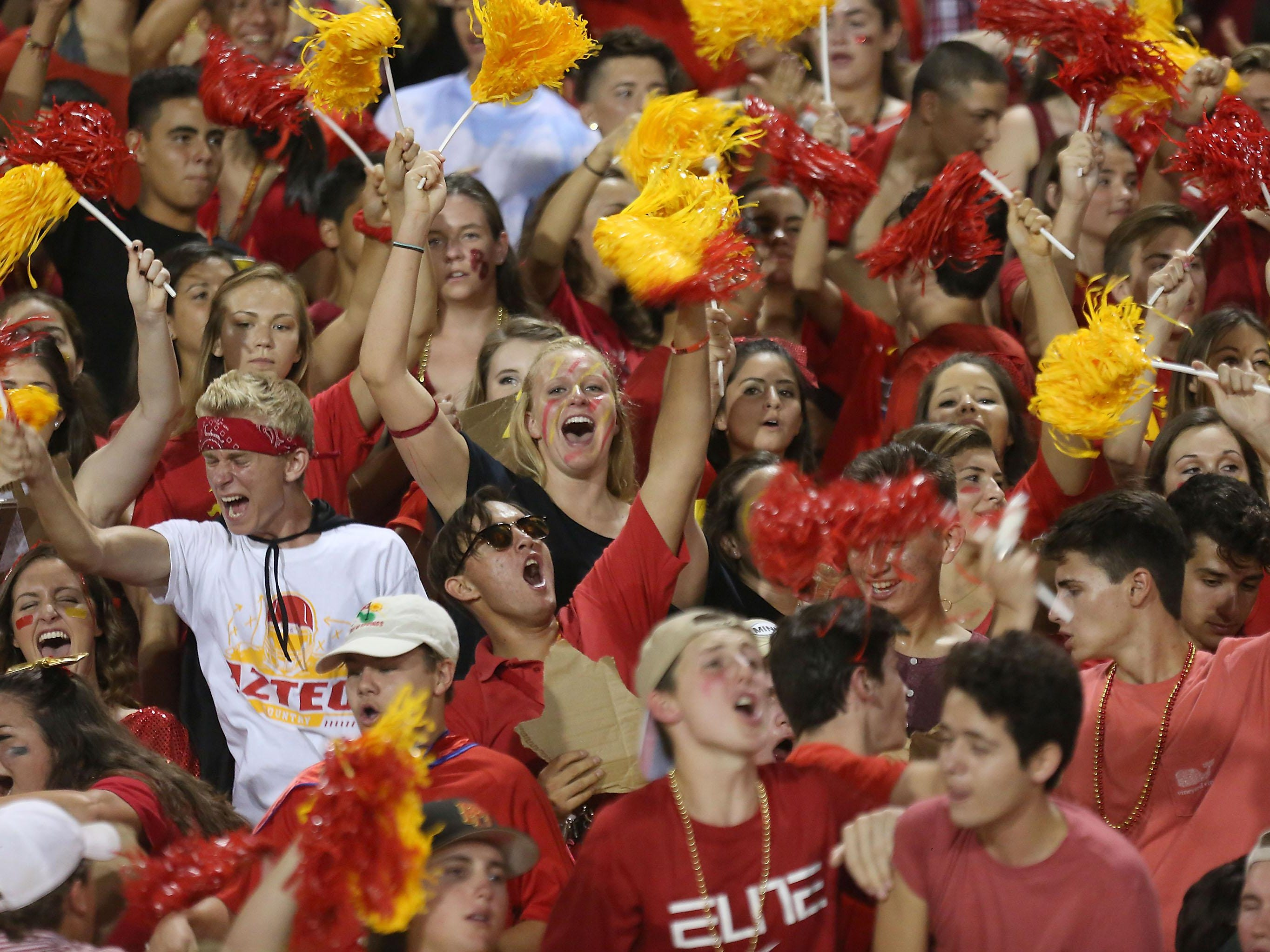 The Palm Desert student section celebrates a touchdown against La Quinta, Friday, September 25, 2015.