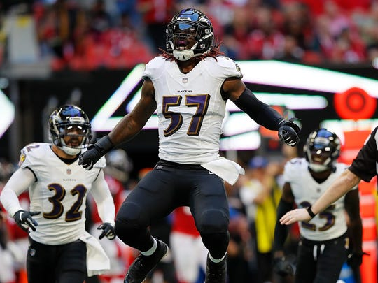Ravens' linebacker C.J. Mosley reacts after a defensive stop against the Atlanta Falcons at Mercedes-Benz Stadium on Dec. 2, 2018 in Atlanta, Georgia.