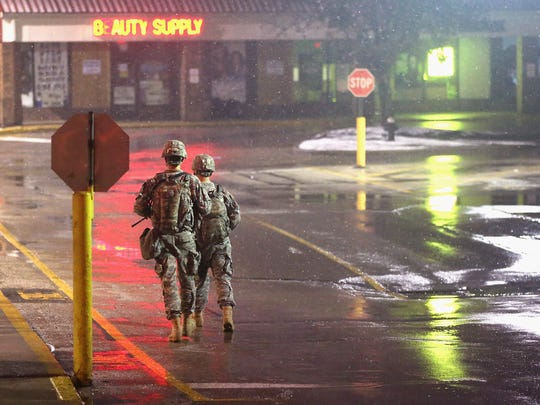 National Guard troops guard a strip mall late Wedensday in Ferguson.