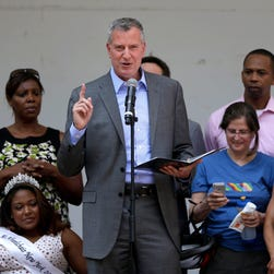 New York City Mayor Bill de Blasio speaks at the inaugural Disability Pride Parade, Sunday, July 12, 2015, in New York.