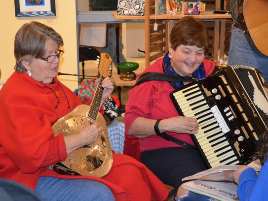 Bobbie Stubee and Donna Pio, both of Millville, perform