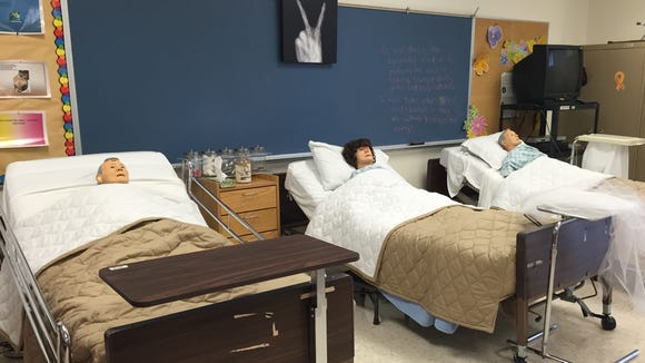 Mannequins sit in a back of a classroom at Silva Health Magnet High School.