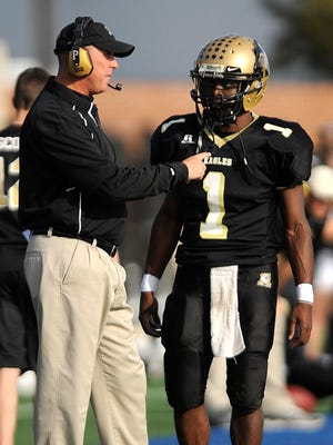 Abilene High head coach Steve Warren gives a play to quarterback Ronnell Sims (1) during the second quarter of the Eagles' 41-17 win over Cedar Hill in the Region I-5A regional round playoff game Nov. 27, 2009, at Birdville Fine Arts/Athletics Complex in North Richland Hills.