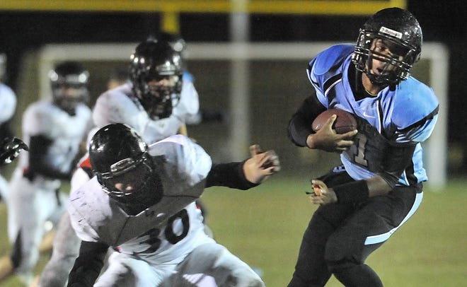 Bishop Kearney's Tyler Kirton, right, spins away from LeRoy's Nick Egeling.