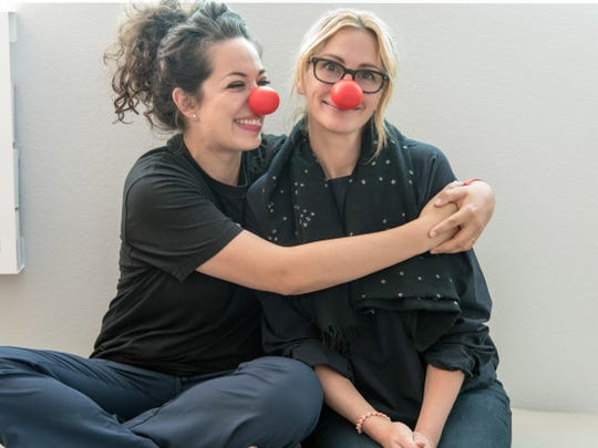 Lacey Khor (left), a nurse at Children's First Academy in Phoenix, met with Julia Roberts two weeks ago.
