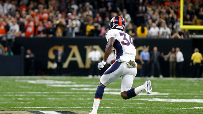 Denver Broncos defensive back Will Parks (34) grabs a blocked extra point and returns it for a safety in the second half of an NFL football game against the New Orleans Saints in New Orleans, Sunday, Nov. 13, 2016. The Broncos won 25-23. (AP Photo/John McCusker) ORG XMIT: LAGH135