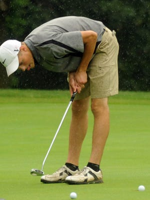 Colin Chapman, 16, of River Valley, reacts as his par putt on the par-3, No. 7 hole just makes it into the hole during a rain-shortened Heart of Ohio Junior Golf Association tournament two years ago. HOJGA celebrates its 30th anniversary this summer.