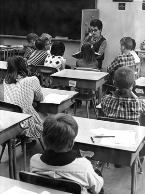 Teacher Jane Elliot reads to privileged, brown-eyed children while the blue-eyed children sit at their desks in a 1968 experiment that divided the class into two groups. Elliot wanted her students to learn firsthand what prejudice and discrimination felt like.