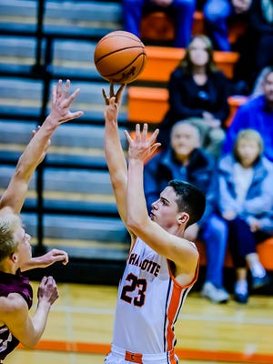 Kyle Peterson of Charlotte hits a jump shot over Eaton Rapids defenders Tuesday in Charlotte.