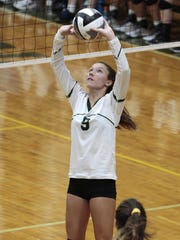 Sophomore setter, Alyssa Herper of McNick sets the