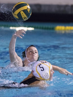 El Diamante's Makenzie Huskey shoots against Golden West in a Central Section Division II girls water polo semifinal on Wednesday, November 16, 2016.