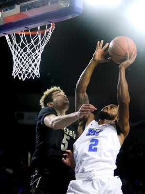 MTSU's Antwain Johnson (2) is fouled by Vanderbilt's Matthew Fisher-Davis (5) as Johnson goes up for a shot during the game, on Thursday, Dec. 8, 2016, at MTSU.