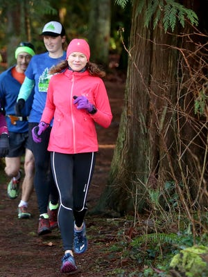 Tabatha Collins, front, runs in the Illahee Preserve in Bremerton in 2017 in honor of her late brother, Todd, who died of an overdose. She is working toward running 52 ultramarathons in 2019 to raise money for Kitsap Mental Health Services and in honor of her brother's age, which would have been 52 this year.